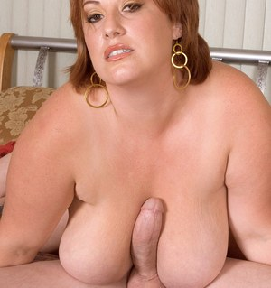 Fat mom Nikki Cars gets a big cock hard before riding it to cumshot conclusion