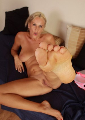 Hot middle-aged lady Olga spreads her toes after removing her high heels