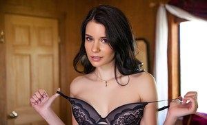 Latina female Salena Storm wiggles free of black lingerie for centerfold shoot