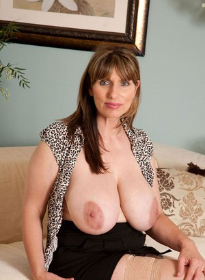 Middle aged lady Josephine James whips out her hooters before hiking her skirt