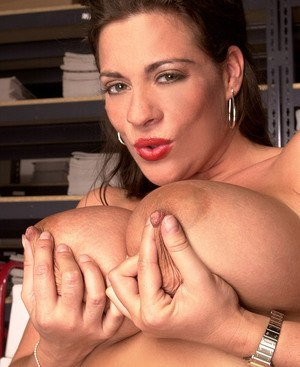Big titted female Linsey Dawn McKenzie exposes her clit out in the warehouse