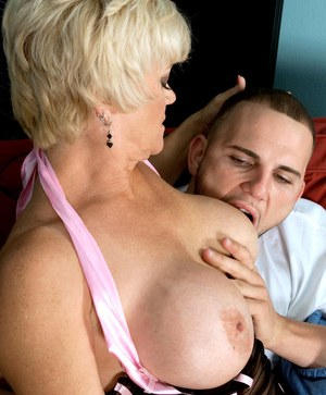 Big titted grandma Destiny Anne seduces the paperboy in sexy lingerie