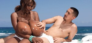 Black masseuse Miosotis seduces her client by exposing her massive boobs