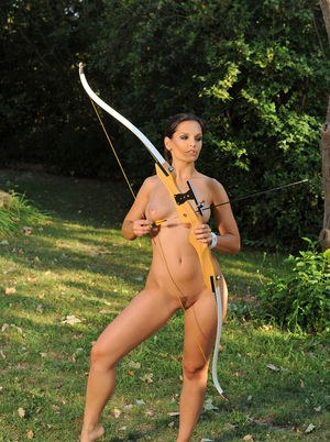 Hot MILF Eve Angel strips naked before target practice in the woods