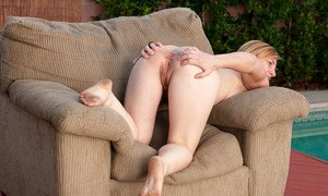 Older lady Cody Hunter reveals her hairy muff on a comfortable old chair