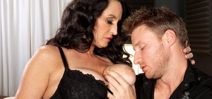 Dark haired granny Rita Daniels pleases her young lover's dick with oral sex