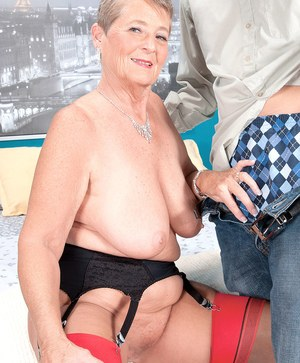 Short haired grandmother Joanne Price gives her young lover a chipmunking BJ