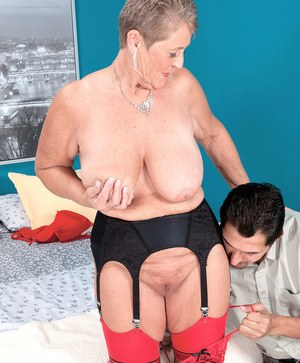 Naughty granny Joanne Price seduces a younger man in stockings and garters