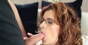 Glasses wearing grandma Mayna May sucks cock until a sperm eruption happens