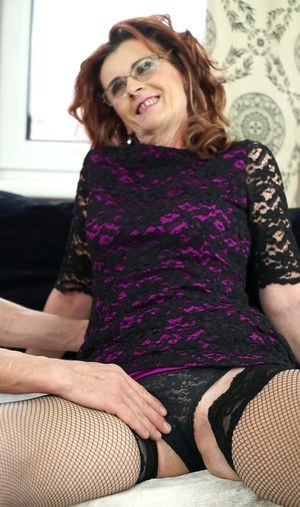 Horny granny Mayna May bangs her boy toy's big cock in glasses and mesh hose