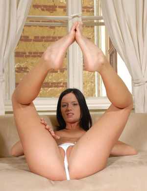 Brunette MILF Suzy Black releases her white underwear from her cameltoed twat
