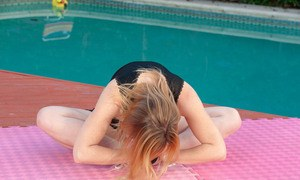 Middle-aged broad Cody Hunter undresses by pool before teasing her pussy