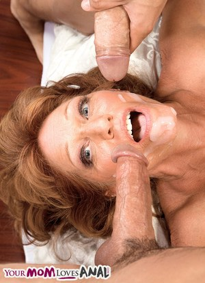 Mature lady Sheri Fox pleases two younger guys at the same time with ease