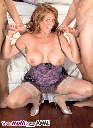 Mature lady Sheri Fox takes a dick in her ass while blowing another one