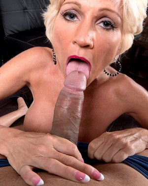 Hot older lady with blonde hair swallows a mouthful of cum after giving a BJ