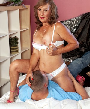 Mature lady shows a young buck with a big dick a few tricks