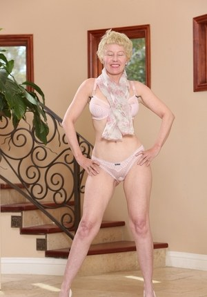 Hot mature woman Dalny Marga bares her big tits as she gets undressed