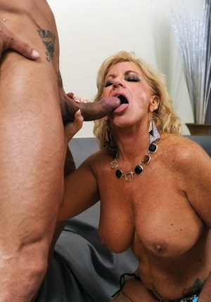 Big breasted older lady Zena Rey licks and sucks a cock on her knees