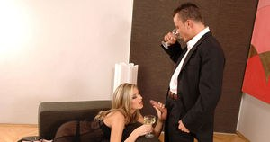 Sexy MILF Cherry Jul enjoys a glass of wine while giving a blowjob