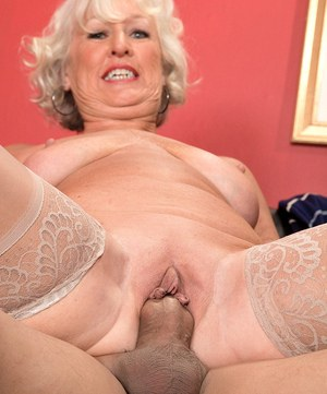 Horny grandma Jeannie Lou seduces a younger Latina male in sheer stockings