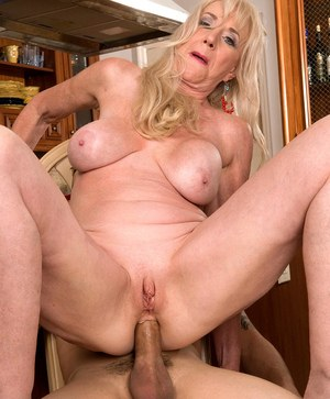 Hot grandmother Summeran Winters seduces the delivery boy in a red dress