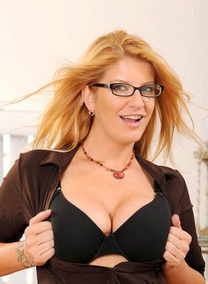 Middle-aged female in glasses and pantyhose undresses for a quick finger fuck