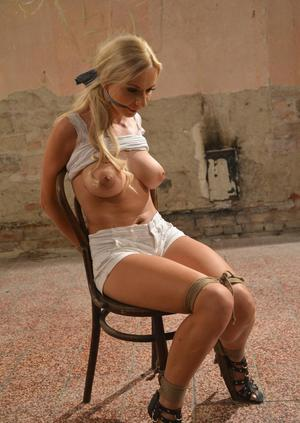 Tied up blonde chick has her nice tits fondled against her will