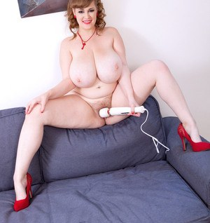 Big boobed female Smiley Emma whips out a magic wand to masturbate with