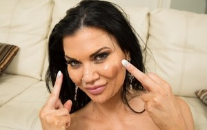 Dark haired female Jasmine Jae has her face covered in jizz by a bunch of men