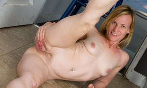 Mature woman Cody Hunter goes barefoot while undressing in doorway