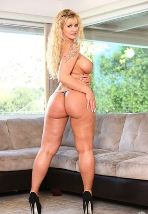 Chunky mature mom Ryan Conner poses nude with the curtains wide open