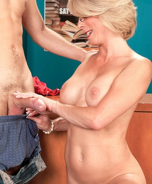 Blonde cougar Jenny Mason sucks a young boy's dick in the nude