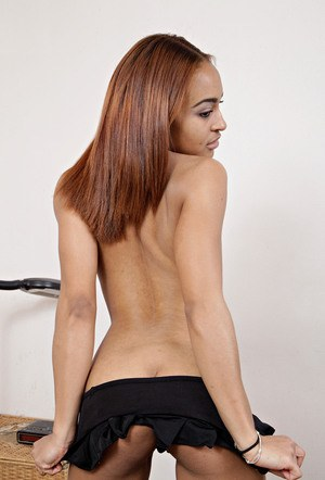 Tiny balck girl with redhead flashes her tiny boobs before getting fully naked