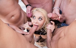 Petite blonde Marsha May gets banged by a roomful of men in black stockings