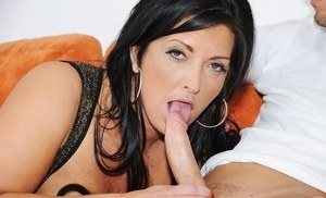 Dark haired female Sammy Brooks goes all the way down a cock while giving a BJ