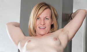 Older lady Cody Hunter hikes up her skirt to begin showing off her snatch