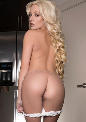 Hot blonde Ria Rose sheds her white lingerie to model naked atop kitchen table