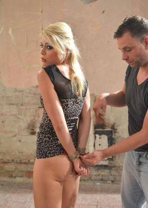 Blonde chick Sandy is ball gagged and tied up with rope until she's helpless