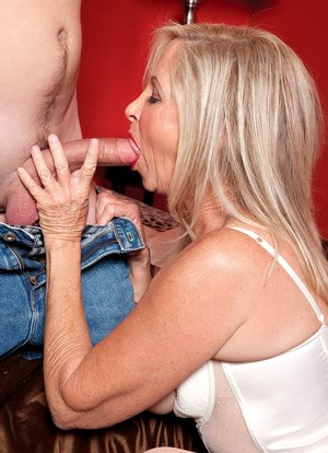 Hot cougar Connie McCoy pleases her boy toy in white lingerie and stockings