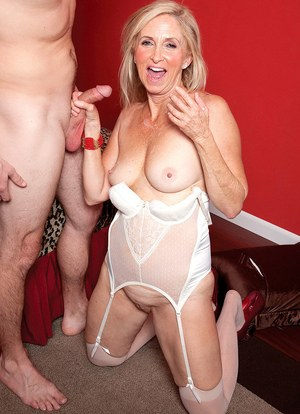 Naughty granny Connie McCoy seduces a young boy and lets him ass fuck her