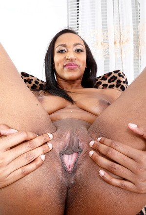 Black amateur Britney Lee Hunter strips and shows off the pink of her twat