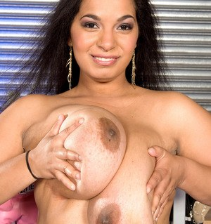Chubby solo model Camelia Davis plays her her huge saggy boobs in leg warmers