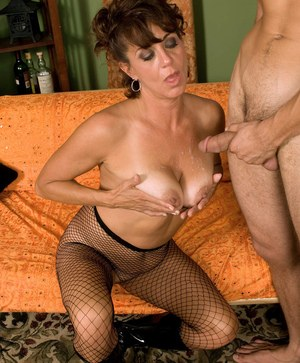 Topless granny Jamy Nova seduces a young boy in mesh hose and black boots