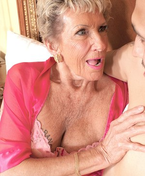 Grandmother Sandra Ann fucks her Latino gigolo until he blows his load of jism