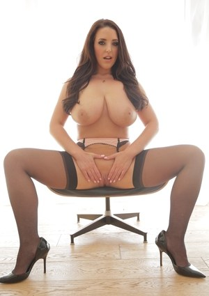 Latina MILF Angela White shows off her hooters and booty in black stockings