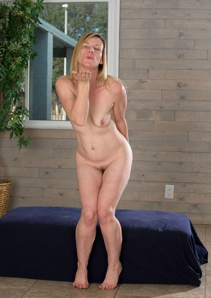 Older lady Cody Hunter blows a kiss after undressing for nude posing