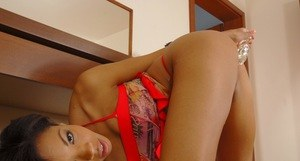Black dime Luciana teases in a thong before she inserts a dildo in her pussy