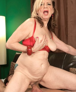 Blond cougar Miranda Torri seduces a younger guy in a half cup bra and panties