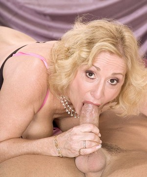Blonde granny Cee Cee sucks a younger man's fat cock like a young nymph