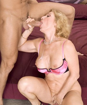 Naughty granny Cee Cee seduces a young boy in her bra and panties